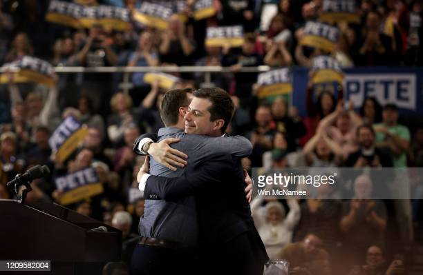 Democratic presidential candidate former South Bend Indiana Mayor Pete Buttigieg hugs his husband Chasten after speaking at a town hall campaign...