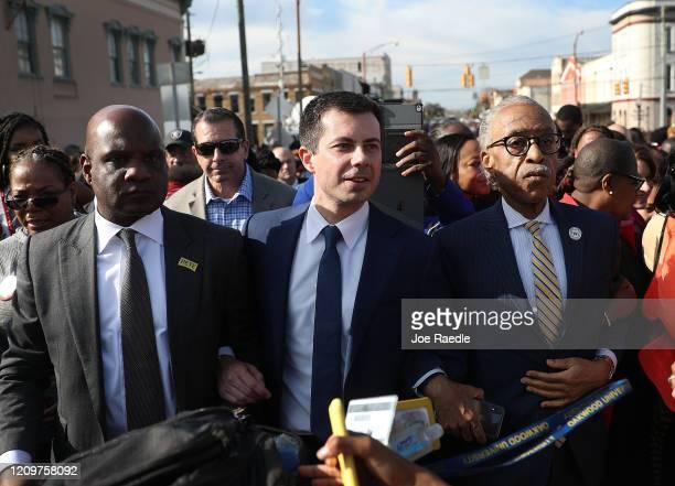 Democratic presidential candidate former South Bend Indiana Mayor Pete Buttigieg and the Rev Al Sharpton participate in the Edmund Pettus Bridge...