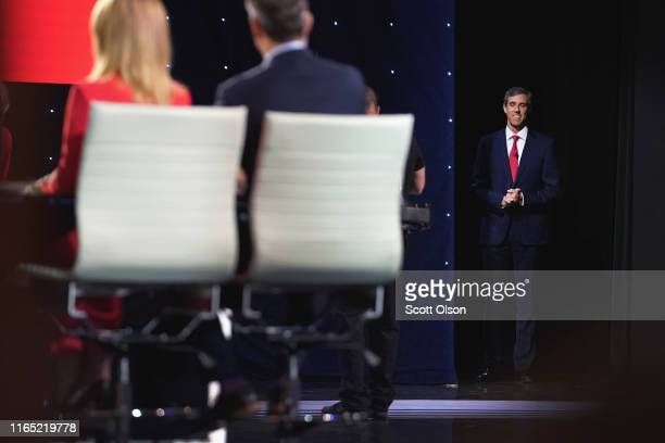 Democratic presidential candidate former Texas congressman Beto O'Rourke takes the stage at the beginning of the Democratic Presidential Debate at...