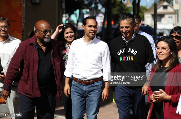 Democratic presidential candidate former US Housing Secretary Julian Castro talks with Oakland city Councilmember Noel Gallo and Post Newspaper Group...