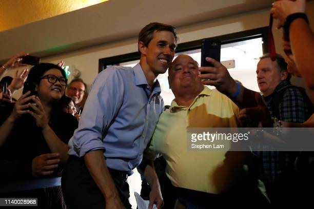 Democratic presidential candidate former US Rep Beto O'Rourke takes a selfie with a supporter during a campaign town hall at the Irish Cultural...