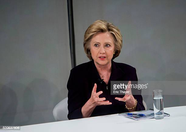 Democratic presidential candidate former US Secretary of State Hillary Clinton attends a roundtable discussion on pay equality April 12 2016 in New...
