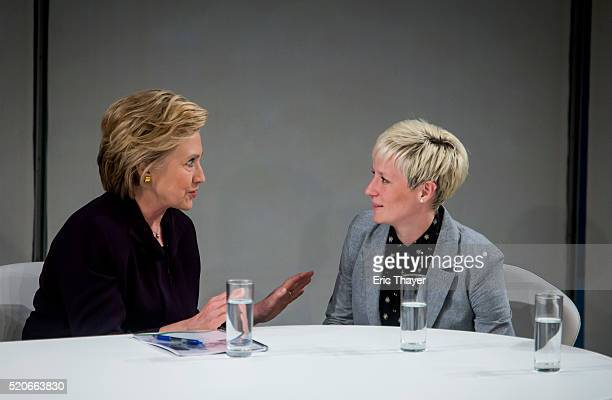 Democratic presidential candidate former US Secretary of State Hillary Clinton talks with Women's World Cup soccer champion and Olympic gold medalist...