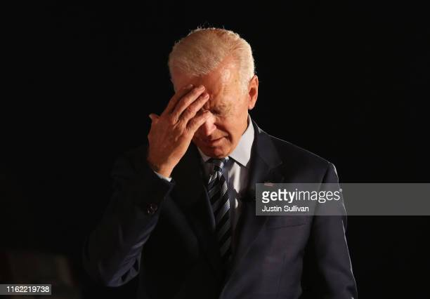 Democratic presidential candidate former US Vice President Joe Biden pauses as he speaks during the AARP and The Des Moines Register Iowa...