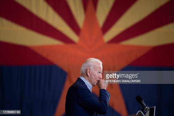 Democratic presidential candidate former US Vice President Joe Biden speaks to supporters in front of an Arizona state flag, at the United...