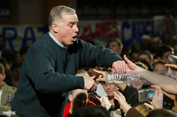 Democratic presidential candidate former Vermont Governor Howard Dean is greeted by supporters during a rally at Iowa State University on caucus day...