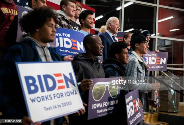 Democratic presidential candidate, former Vice President Joe Biden poses for a photograph with students during an event at Iowa Central Community...