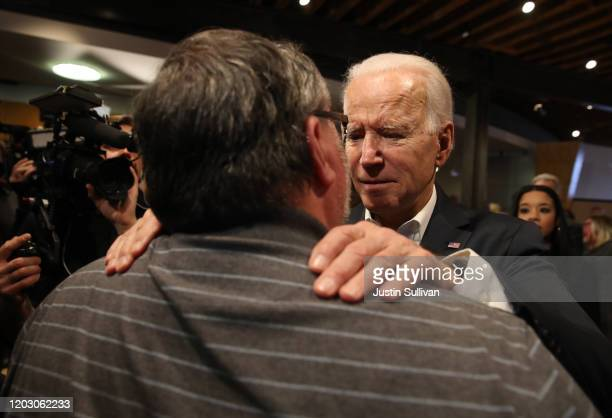 Democratic presidential candidate former Vice President Joe Biden greets a voter during a campaign event at Vince Meyer Learning Center on January...