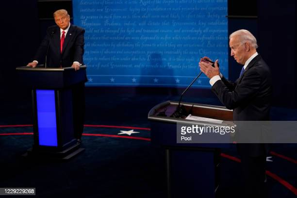 Democratic presidential candidate former Vice President Joe Biden answers a question as President Donald Trump listens during the second and final...