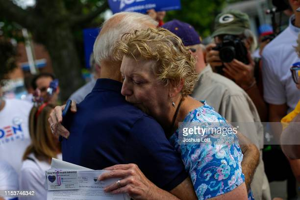 Democratic presidential candidate, former Vice President Joe Biden hugs an attendee during the Fourth of July parade on July 4, 2019 in Independence,...