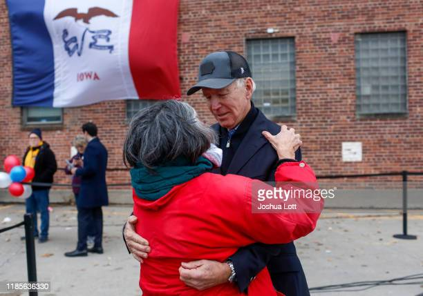Democratic presidential candidate, former Vice President Joe Biden hugs an attendee during a campaign event on November 30, 2019 in Council Bluffs,...