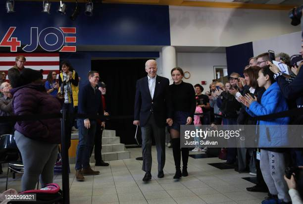 Democratic presidential candidate former Vice President Joe Biden and his granddaughter Finnegan Biden arrive at a campaign event on February 02 2020...