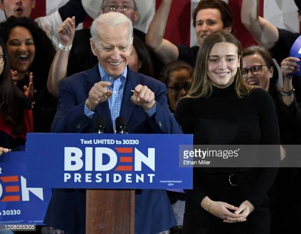 Democratic presidential candidate former Vice President Joe Biden and his granddaughter Finnegan Biden are greeted as they arrive at a Nevada caucus...
