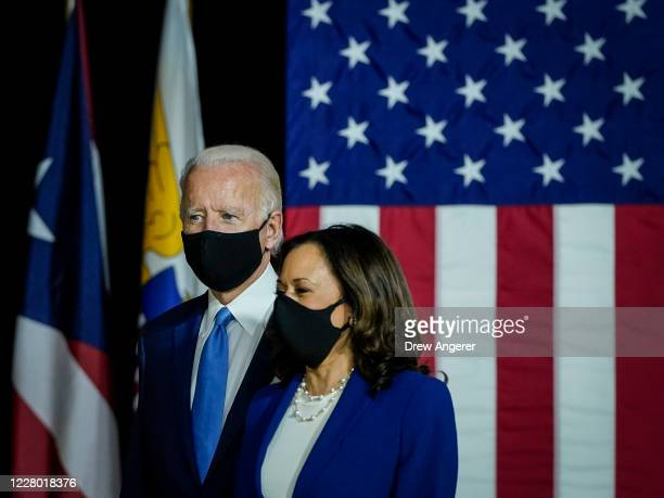 Democratic presidential candidate former Vice President Joe Biden and his running mate Sen. Kamala Harris arrive to deliver remarks at the Alexis...