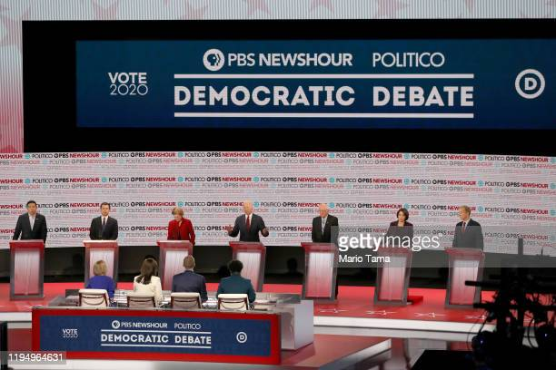 Democratic presidential candidate former Vice President Joe Biden speaks as former tech executive Andrew Yang, South Bend, Indiana Mayor Pete...