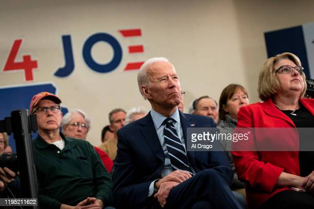 Democratic presidential candidate, former Vice President Joe Biden listens as he sits in the audience during an event on January 21, 2020 in Ames,...