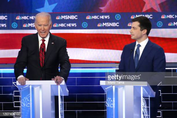 Democratic presidential candidate former Vice President Joe Biden speaks as former South Bend, Indiana mayor Pete Buttigieg listens during the...