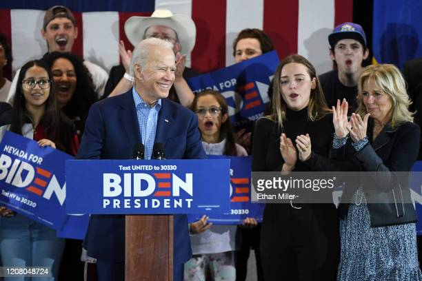 Democratic presidential candidate former Vice President Joe Biden speaks as his granddaughter Finnegan Biden and wife Dr Jill Biden look on during a...