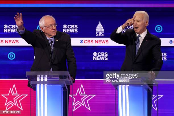 Democratic presidential candidate former Vice President Joe Biden speaks as Sen Bernie Sanders looks on during the Democratic presidential primary...