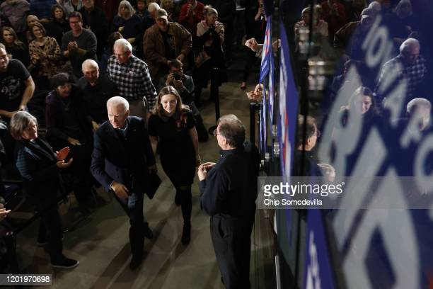 Democratic presidential candidate former Vice President Joe Biden arrives at a town hall meeting with his granddaughter Finnegan Biden in the John...