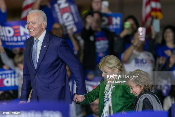 Democratic presidential candidate former Vice President Joe Biden accompanied by his wife Jill Biden and sister Valerie Biden Owens take to the stage...