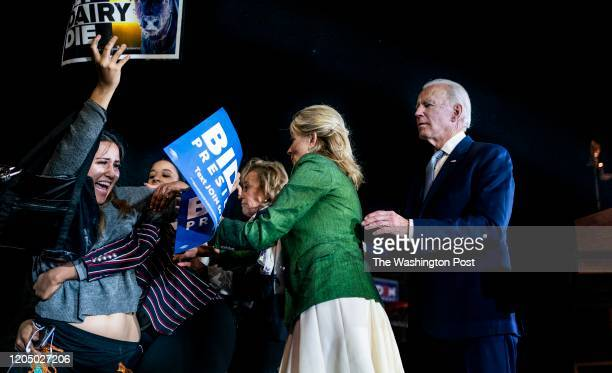 Democratic Presidential candidate former Vice President Joe Biden accompanied by his wife Dr Jill Biden cope with protestors that got up on the stage...