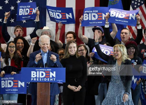 Democratic presidential candidate former Vice President Joe Biden his wife Dr Jill Biden and their granddaughter Finnegan Biden are greeted as they...