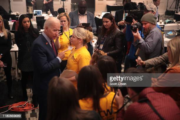 Democratic presidential candidate former vice president Joe Biden arrives in the spin room to speak to the press after addressing the United Food and...