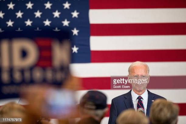 Democratic presidential candidate former Vice President Joe Biden stands on stage while the crowd applauds during a campaign event on October 9 2019...