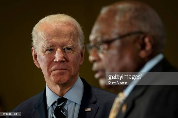 Democratic presidential candidate former Vice President Joe Biden looks on as US Rep and House Majority Whip James Clyburn announces his endorsement...
