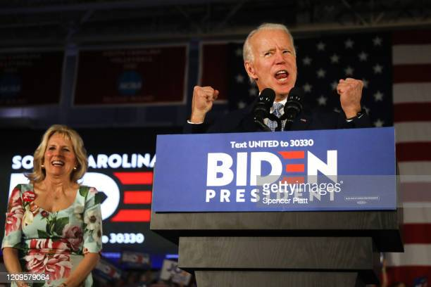 Democratic presidential candidate former Vice President Joe Biden reacts on stage with his wife Jill Biden after declaring victory in the South...