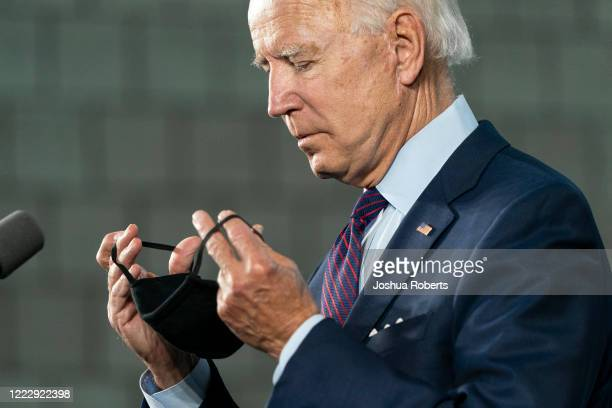 Democratic presidential candidate former Vice President Joe Biden puts on a mask after speaking during an event about affordable healthcare at the...