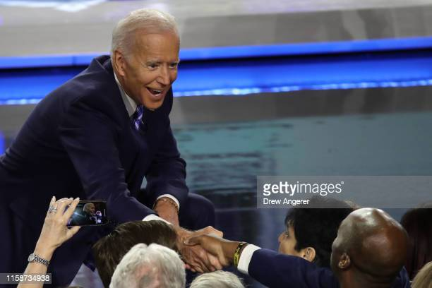 Democratic presidential candidate former Vice President Joe Biden greets members of the audience after the second night of the first Democratic...