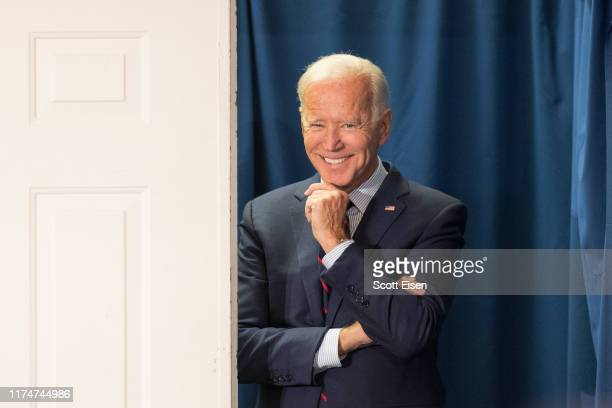 Democratic presidential candidate former Vice President Joe Biden peeks out from backstage during a campaign event on October 9 2019 in Rochester New...
