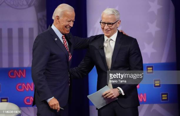 Democratic presidential candidate former Vice President Joe Biden embraces CNN moderator Anderson Cooper at the Human Rights Campaign Foundation and...