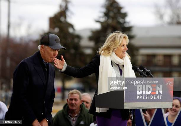 Democratic presidential candidate former Vice President Joe Biden bites the finger of his wife Jill Biden as she introduces him during a campaign...