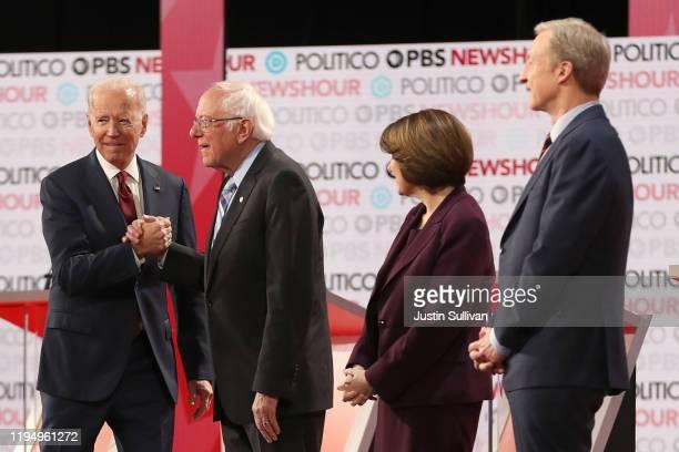 Democratic presidential candidate Former Vice President Joe Biden greets Sen Bernie Sanders as Sen Amy Klobuchar and Tom Steyer look on before the...