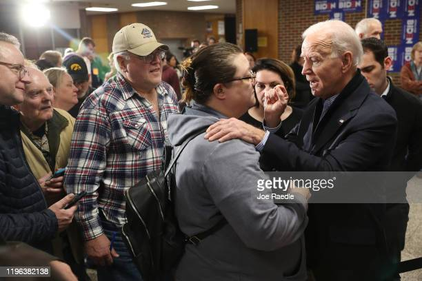 Democratic presidential candidate former Vice President Joe Biden speaks with Samantha Zieglowsky during a campaign stop at Tipton High School on...