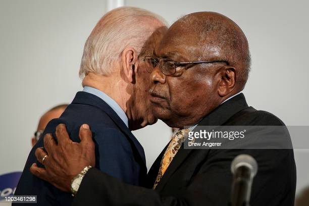 Democratic presidential candidate former Vice President Joe Biden shakes and US Rep and House Majority Whip James Clyburn embrace as Clyburn...