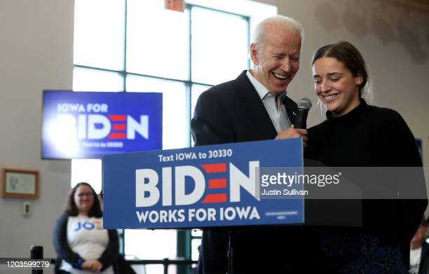 Democratic presidential candidate former Vice President Joe Biden talks with his granddaughter Finnegan Biden during a campaign event on February 02...
