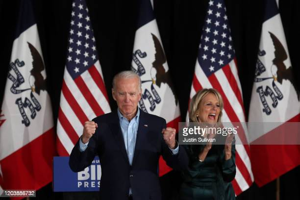 Democratic presidential candidate former Vice President Joe Biden takes the stage to address supporters with his wife Dr Jill Biden during his caucus...