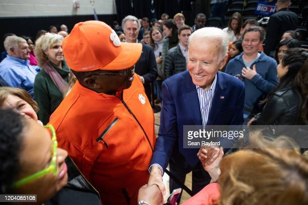 Democratic presidential candidate former Vice President Joe Biden shakes hands with supporters during a campaign event at Wofford University February...