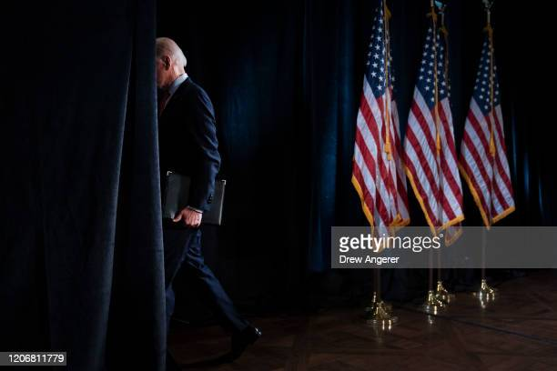 Democratic presidential candidate former Vice President Joe Biden leaves the lectern after delivering remarks about the coronavirus outbreak, at the...