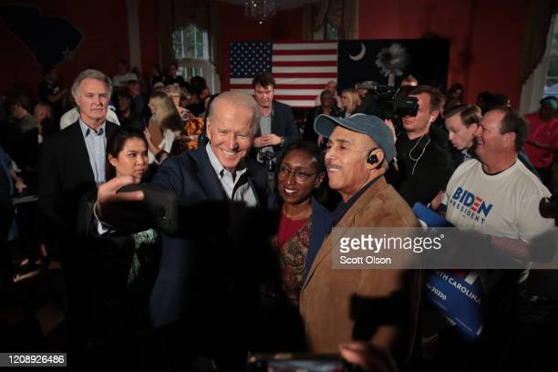 Democratic presidential candidate former Vice President Joe Biden greets guests during a campaign stop at the Winyah Indigo Society Hall on February...