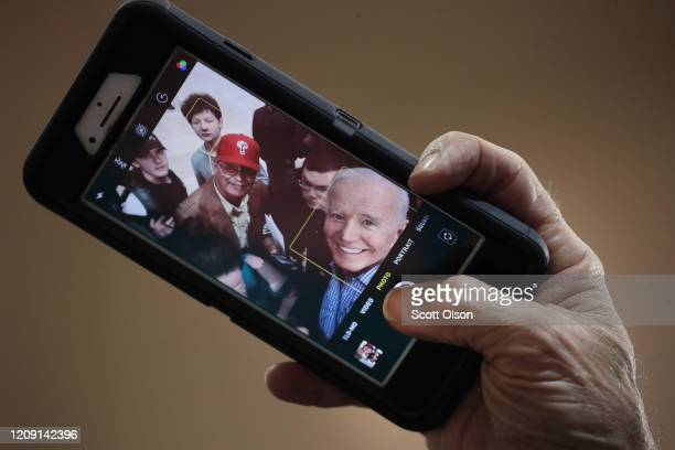 Democratic presidential candidate former Vice President Joe Biden takes selfies with guests during a campaign rally at Coastal Carolina University on...
