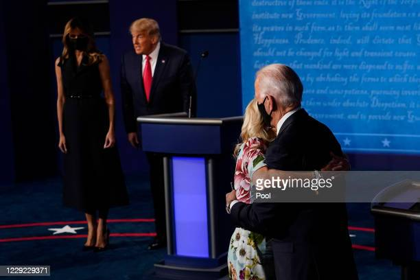 Democratic presidential candidate former Vice President Joe Biden hugs wife Jill Biden as President Donald Trump stands first lady Melania Trump...