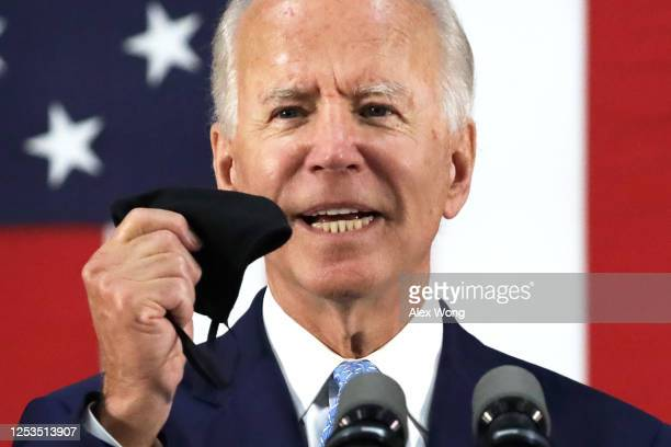 Democratic presidential candidate, former Vice President Joe Biden holds up a mask as he speaks during a campaign event June 30, 2020 at Alexis I....