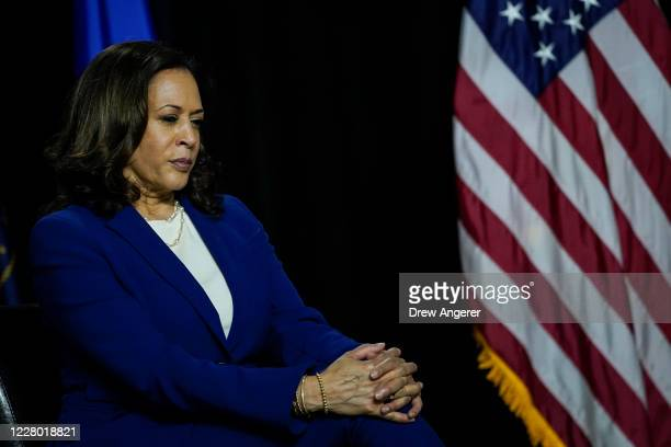 Democratic presidential candidate former Vice President Joe Biden's running mate Sen. Kamala Harris listens to Biden make remarks at the Alexis...