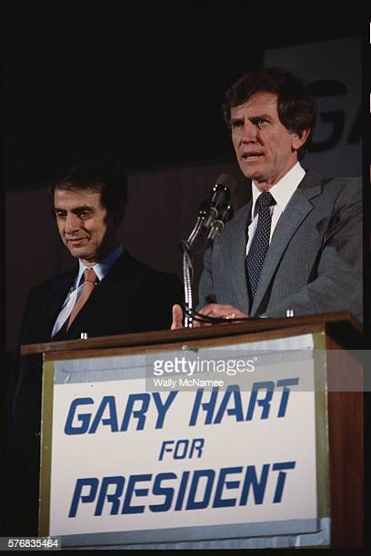 Democratic presidential candidate Gary Hart speaks during a rally Standing with him is astronomer Carl Sagan