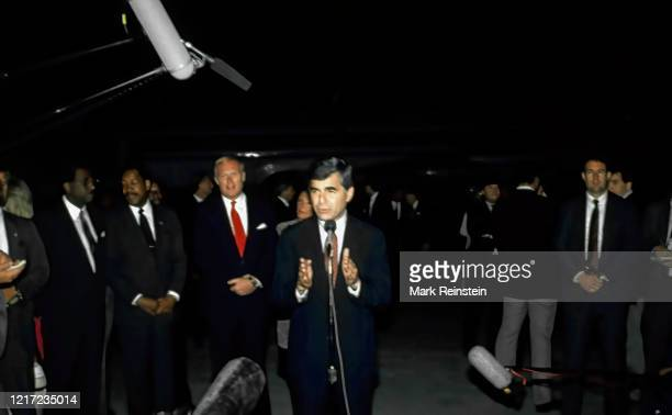 """Democratic Presidential candidate Governor of Massachusetts Michael Dukakis speaking upon arrival at O""""u2019Hare airport. Neil Hartigan is behind him..."""